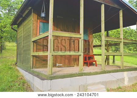 Small House Cabin Shed. Cute Summer Cabin In Rural Orchard
