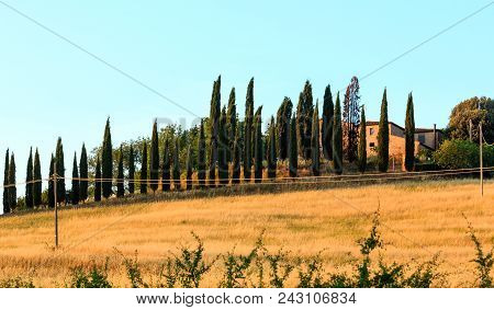 Tuscany, Italy-  June 23, 2017: Beautiful Landscape Of Summer Countryside In Italy With House, Hills