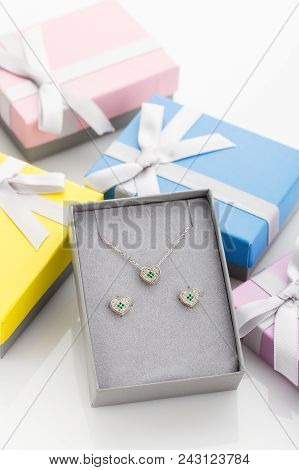 Jewelry Set Of Heart Necklace And Stud Earrings With White And Green Crystals In Gift Box. Gift Idea