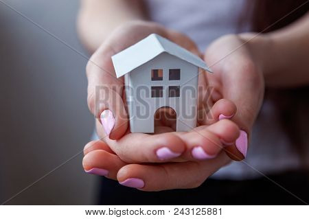 Female Hands Holding Small Miniature White Toy House. Mortgage Property Insurance Dream Moving Home