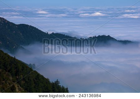 Mountain Ridge Overlooking A Sea Of Clouds Taken In The San Gabriel Mountains, Ca