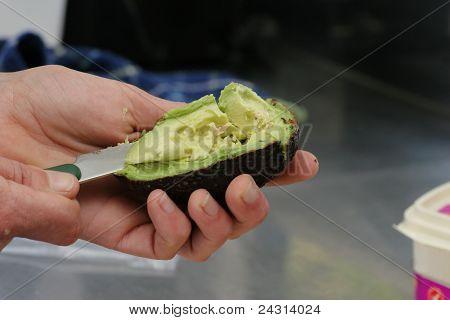 Cutting open avocado