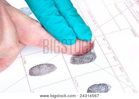A man is being finger printed for either a crime of for FBI screening on a legal document form. poster