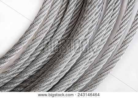 Coils Of Steel Stout Rope. Close-up. Isolated.