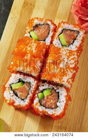 Asian menu. California Roll - in Masago caviar with salmon and avocado inside