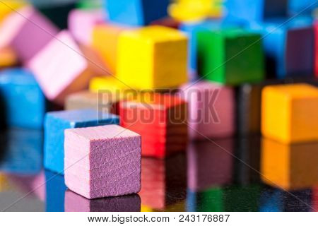 Closeup, Lots Of Colorful Cubic Toy Blocks With Reflections