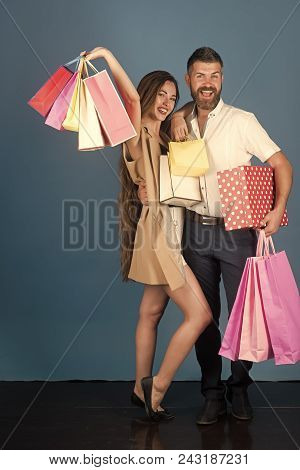 Sexy Couple. Girl And Bearded Man Hold Present Pack, Cyber Monday. Couple In Love Hold Shopping Bag