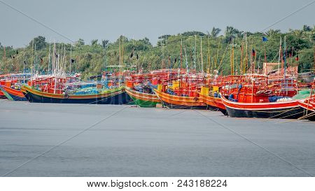 Sunderbans, West Bengal, India - June 5, 2017: Wooden Fishing Boats Painted With Different Colors Li