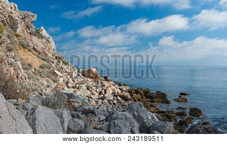 Black Sea Rocky Wild Beach In Natural Reserve On Cape Martyan, Crimean Peninsula