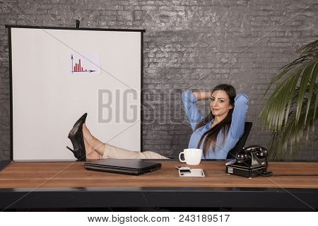 The Corporation's Owner Sits On A Chair And Keeps His Feet On The Desk, The Big Boss