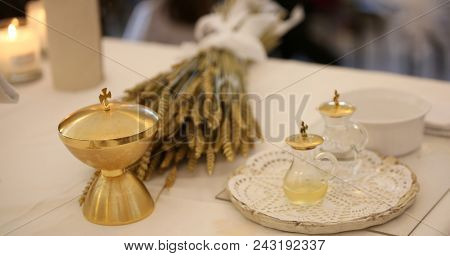 golden calyx and the ears of wheat over an altar in church with the cruets bottles poster