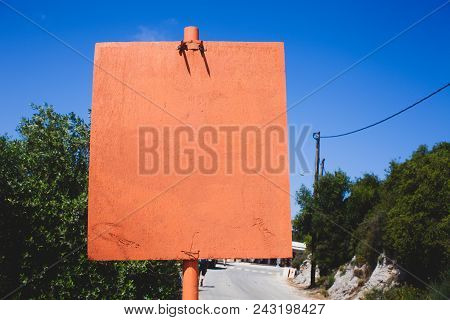 Orange Empty Board Sign By The Road. Copy Space On The Orange Board. Concept With Message On The Emp
