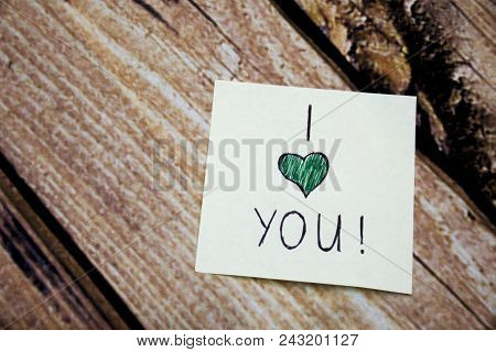 I Love You Emotional Handwritten Message Written On The White Paper With Retro Wooden Bark Backgroun