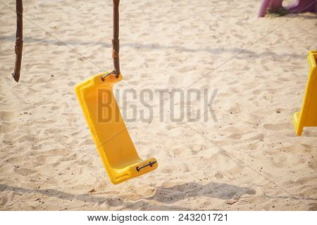 Broken Chain Swing In Playground / Safety In The Playground Concept