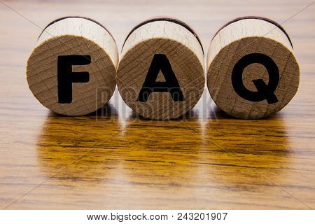 Frequently Asked Questions On The Wooden Round Wheels. Concept Of The Faq Word On The Wooden Backgro
