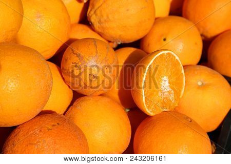Background Of Ripe Organic Oranges Grown Without The Use Of Pesticides