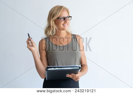 Portrait Of Contemplated Mid Adult Businesswoman In Eyeglasses. Caucasian Woman Wearing Gray Tank To