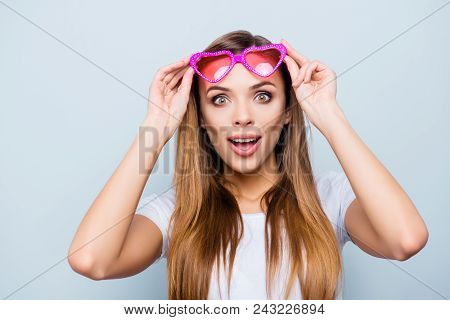 Portrait With Copy Space, Empty Place Of Impressed Wondered Girl Raised Her Pink Glasses In Heart Sh