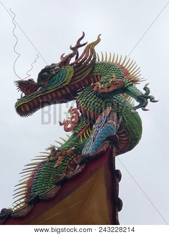 Decoration With Dragon On The Roof Of A Buddhist Temple In Jioufen, Taiwan