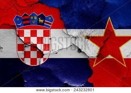 Flags Of Croatia And Yugoslavia On A Wall
