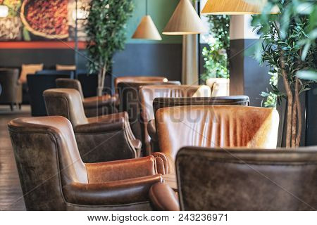 Picture Of Brown Leather Chairs In The Cafe.