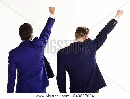 Men In Suit Or Businessmen Raise Fists, Rear View. Business Partners Or Winners In Formal Wear With