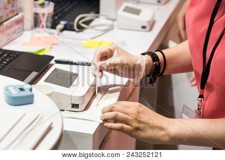 Technician Conducting Oral Health Test Via Saliva Analysis With Advanced Equipment