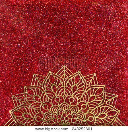 A Gold Mandala Half Circle Over Red Holographic Glitter Background.