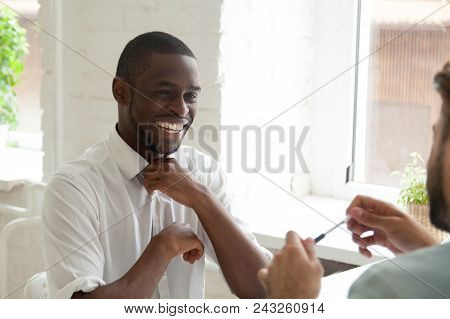 Smiling African American Worker Laughing Talking To Colleague During Work Break. Diverse Coworkers H