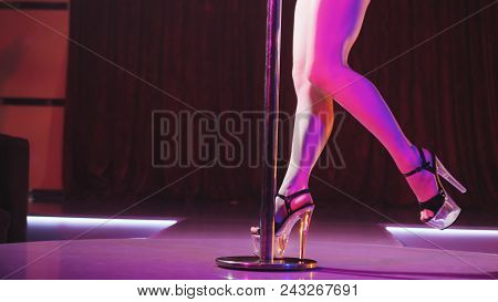 Young Sexy Slim Woman Pole Dancing Striptease With Pylon In Night Club. Beautiful Naked Stripper Gir