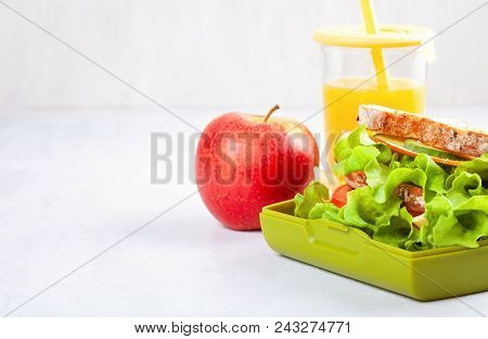 Fresh Sandwich, Apple And Orange Juice For Healthy Lunch Of A Kid Or A Student In The Plastic Lunch