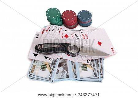 Playing cards and folding knife on a white background
