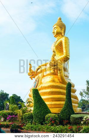 statue gold Buddha near Big Buddha on high hilltop Phuket Thailand sky background morning time poster