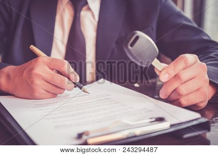 Real Estate Agent Holding Key Car To His Client After Signing Contract,concept Insurance With Car, M