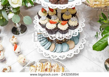 Candy Bar. Delicious sweet buffet with cupcakes. Sweet holiday buffet with cupcakes poster