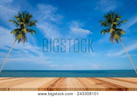 Empty Wooden Table And Palm Leaves With Party On Beach Background In Summer Time, Tropical Palm On A
