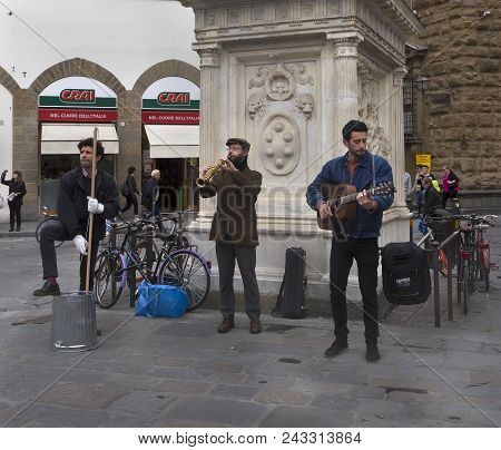 Florence/italy- April 11, 2018:  An Unidentified Three Street Musicians  Playing Music.