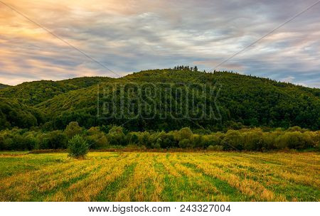 Rural Fields In Mountainous Area At Dawn. Lovely Agriculture Scenery Under The Gorgeous Colorful Clo