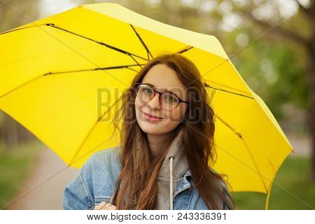 Young Woman With Yellow Umbrella