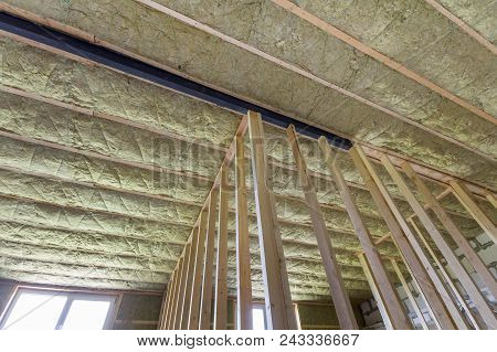 Close-up Of Wooden Frame For Future Walls And Ceiling Insulated With Rock Wool And Fiberglass Insula