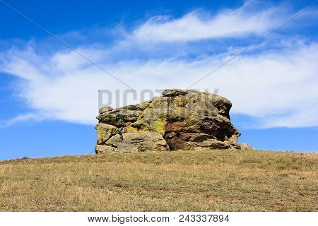 Big Inexplicable Square Stone Structure Under The Summer Blue Sky With White Clouds In Suvinian Saxo