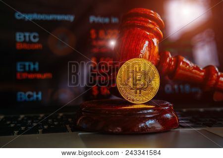 Law Or Auction Gavel And Bitcoins On A Wooden Desk, Dark Background, Gavel And Bitcoin Symbol On Bro