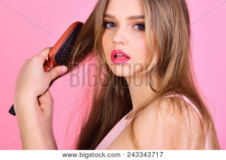 Hairdresser and beauty salon. Haircare and beauty. Girl with hair brush on pink background. Fashion model brush her beautiful hair. Perfect hairdresser. Sexy woman comb long straight hair. poster