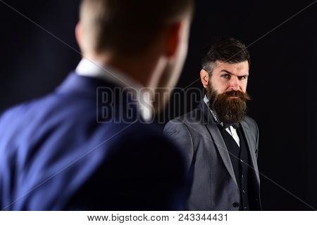 Businessmen Look At Each Other With Judgment. Eye Contact Concept. Business Partners On Serious Face