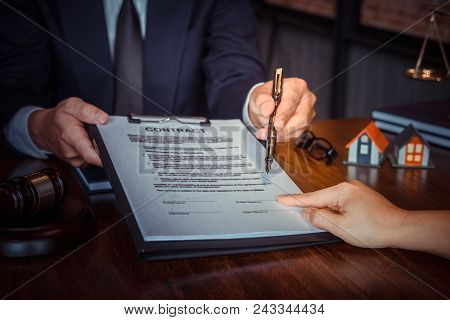 Partner Lawyers Or Attorneys Discussing A Contract Agreement. Successful Businessmen Hand Putting Si