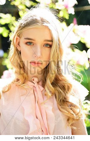 Sensual Woman With Magnolia In Spring. Sensual Woman At Pink Magnolia Flower In Sunlight