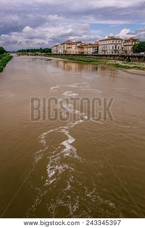 City of Florence, crossed by the Arno river. Typical Renaissance buildings of the city of Michelangelo reflected in the river. poster