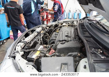 Auto Mechanic Checking Car Engine At The Garage. Car Service -  Technician Checking Or Fixing The En