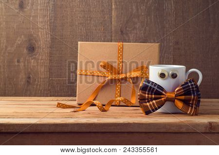 Happy Fathers Day Concept With Coffee Cup, Bow Tie And Gift Box Over Wooden Background