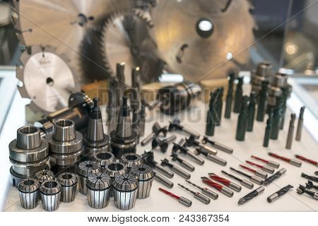 New saws and drills on the stand. New modern industrial drills and mills of the different sizes. Small depth of sharpness. poster